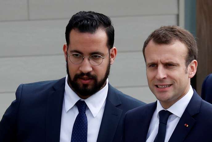 FILE PHOTO: French President Emmanuel Macron and Elysee senior security officer Alexandre Benalla arrive at an elementary school to attend a one-hour interview with French news channel TF1, in Berd'huis